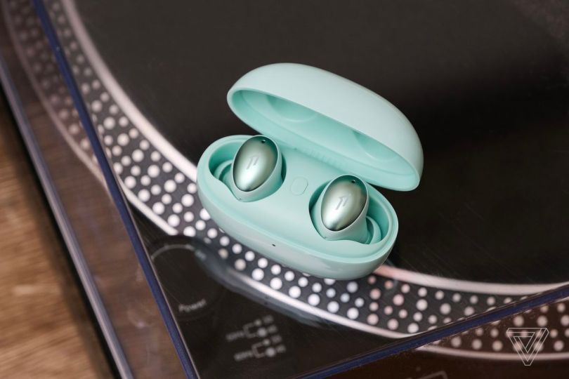 The 1More ColorBuds, the best budget wireless earbuds for style, pictured on top of a turntable.