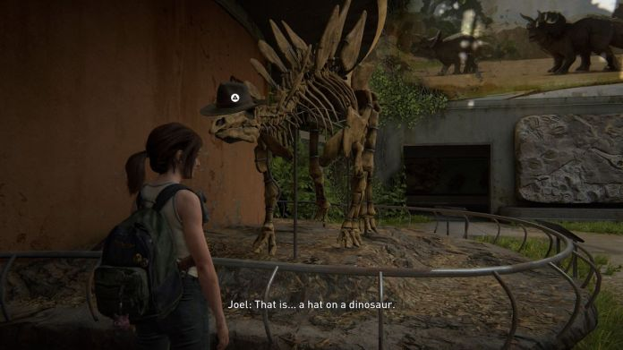 Ellie puts a hat on a dinosaur in The Last of Us Part 2.