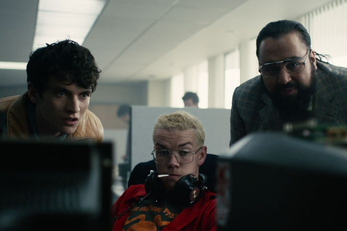 stefan, colin, and mohan look at a computer