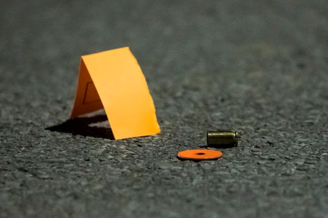 Shell casings sits in the street Saturday night in the 7000 block of South Sangamon, where a 15-year-old boy was wounded in a drive-by shooting in Englewood on the South Side.