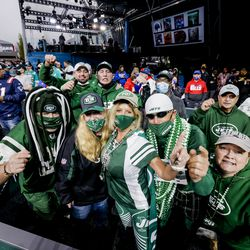 New York Jets fans pose for a photo ahead of the 2021 NFL Draft on Thursday, April 29, 2021 in Cleveland, Ohio.