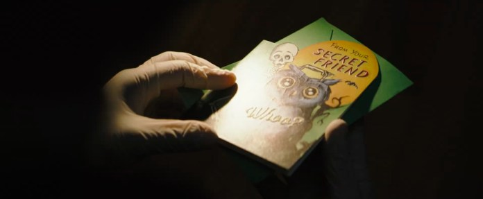 Riddler's greeting card in the Batman 2021