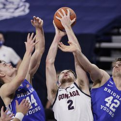 Gonzaga forward Drew Timme (2) grabs a rebound between BYU goalie Connor Harding (44) and center Richard Harward (42) during the first half of an NCAA college basketball game at Spokane, Washington, Thursday January 7, 2021.