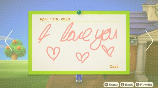 """Animal Crossing: New Horizons - a handdrawn note with """"I love you"""" and hearts on a community bulletin board"""