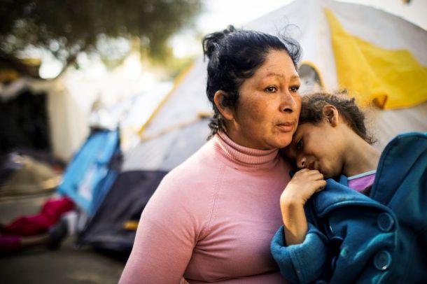 Honduran members of the 'migrant caravan' sit in a temporary shelter set up for members of the caravan on November 26, 2018 in Tijuana, Mexico.