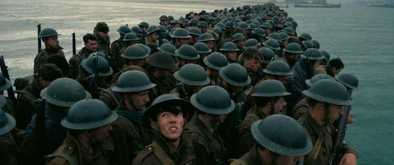 The men watch bombers overhead in Dunkirk.