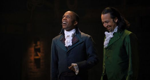 Aaron Burr (Leslie Odom Jr.) and Alexander Hamilton (Lin-Manuel Miranda) take a break from hating each other to share a laugh