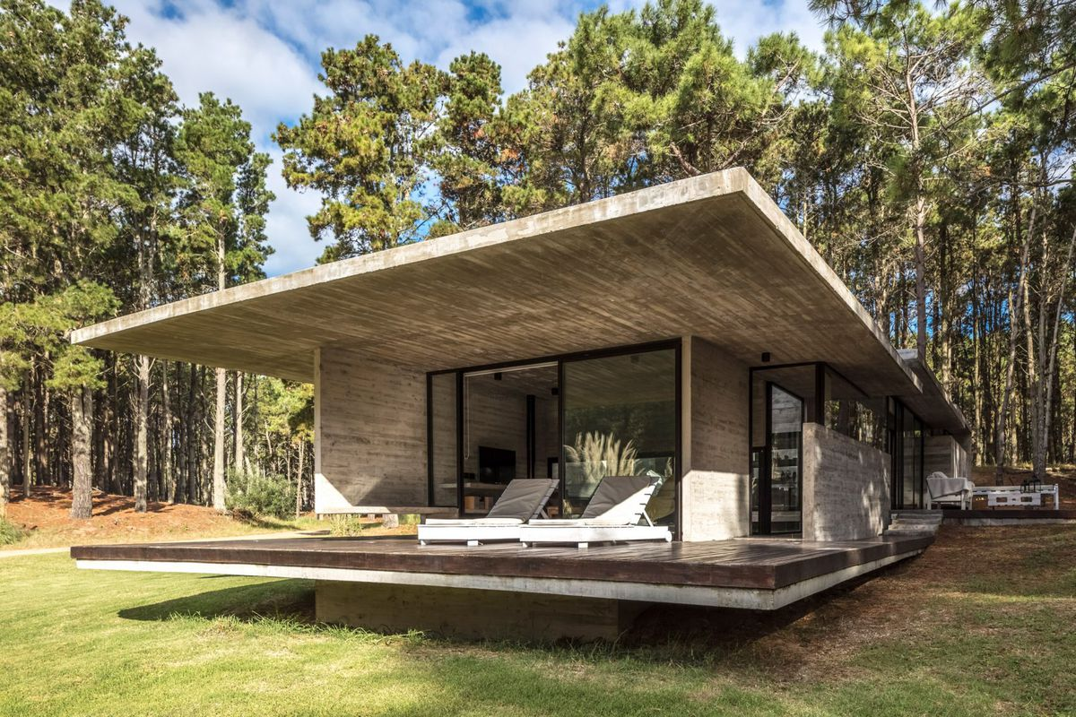 Concrete Summer Home Brings Raw Modernism To The Forest