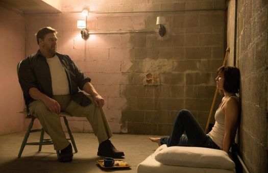 a man and woman inside a small, windowless room