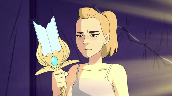 Adora holds the hilt of a shattered sword in She-Ra and the Princesses of Power