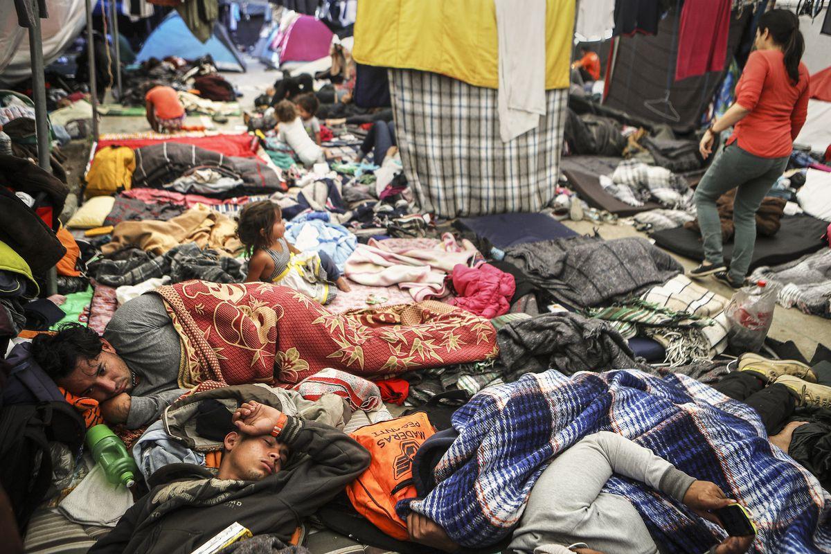 Members of the 'migrant caravan' rest in a temporary shelter set up for members of the caravan on November 26, 2018 in Tijuana, Mexico.