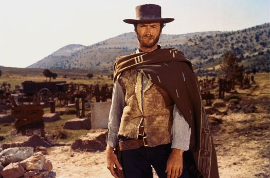 clint eastwood in a hat and poncho