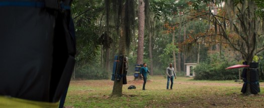 Anthony Mackie and Sebastian Stan frisbee the Captain America shield around, surrounded by padded trees