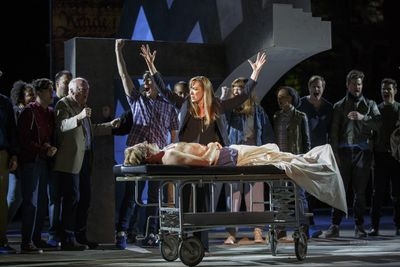 Elizabeth Marvel (as Mark Antony) and the cast of Shakespeare in the Park's Julius Caesar mourn the death of the title character.