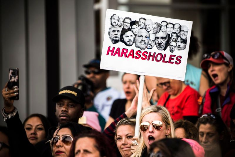 Protesters attend a #MeToo rally in Los Angeles, California on November 12, 2017