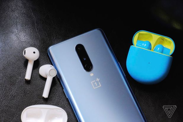 A photo of the white and blue / green OnePlus Buds.