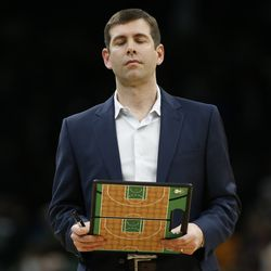 Boston Celtics head coach Brad Stevens holds his clipboard during a timeout in the fourth quarter of an NBA basketball game against the Utah Jazz, Friday, March 6, 2020, in Boston.
