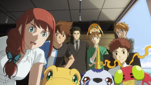 The Digimon cast, humans and Digimon together, all gather around to stare into the camera