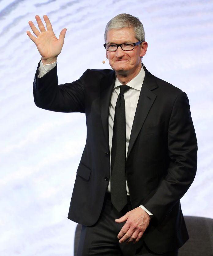 Apple CEO Tim Cook waves to the crowd during a question-and-answer session with members of the Utah tech community in 2016.