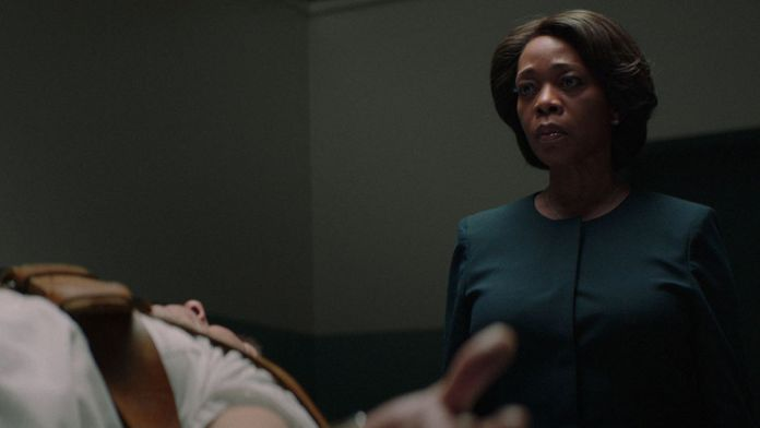 prison warden Bernadine Williams (Alfre Woodard) prepares to execute an inmate