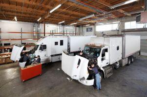 Working in the HyTech garage, retrofitting big diesel trucks.