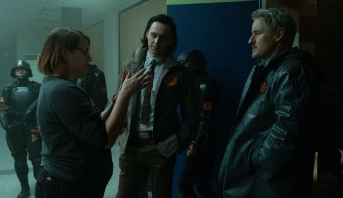 Kate Herron discusses a scene with Tom Hiddleston and Owen Wilson on the set of Loki