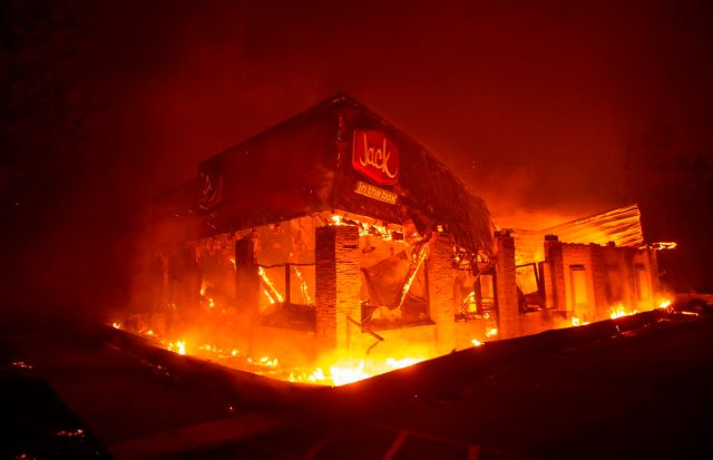A Jack In The Box fast food restaurant burns as the Camp fire tears through Paradise, north of Sacramento, California on November 08, 2018.