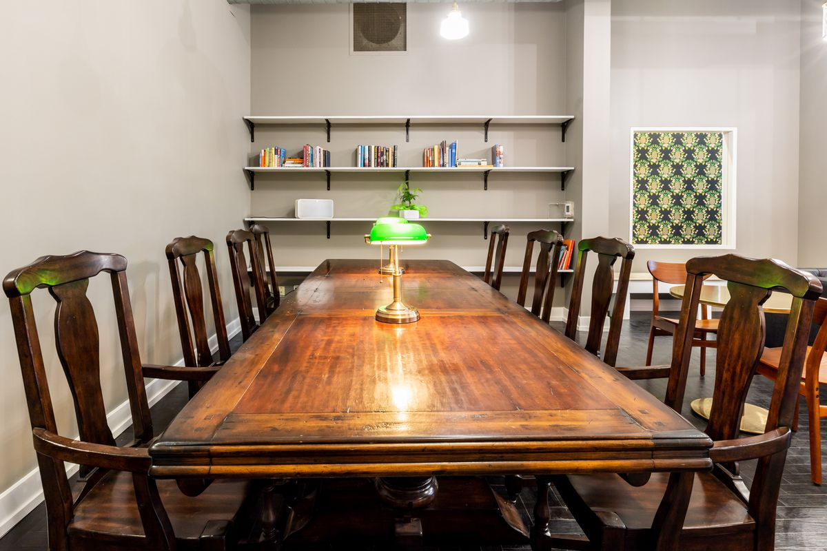 A wood table with lamps