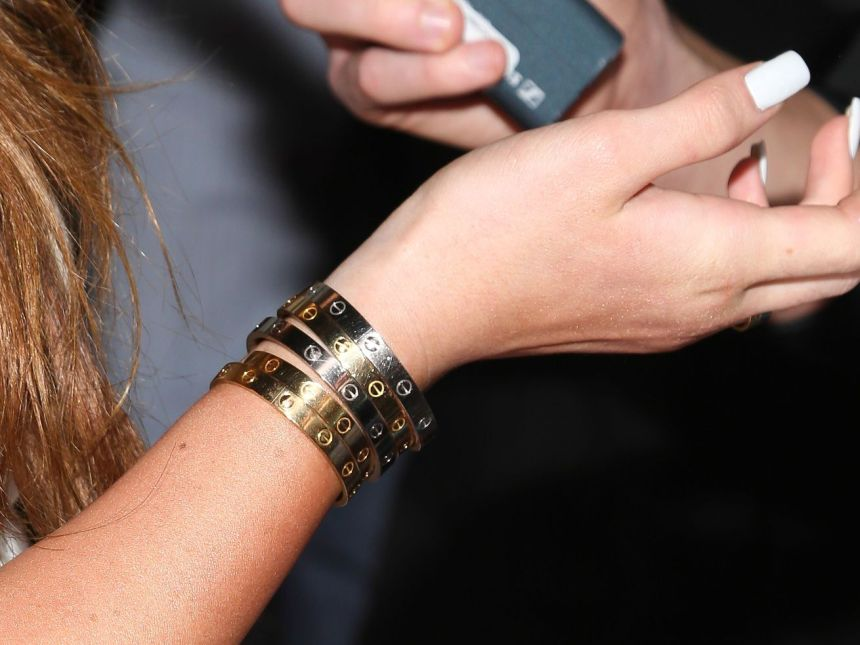 Kylie Jenner wears five Cartier bracelets to a party in Hollywood, California, on November 13, 2013.