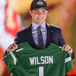 BYU quarterback Zach Wilson poses with a New York Jets jersey after the team selected him with the second pick in the 2021 NFL Draft on Thursday, April 29, 2021 in Cleveland, Ohio.
