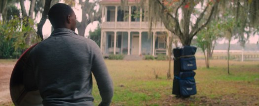Anthony Mackie approaches a padded tree with the Captain America shield