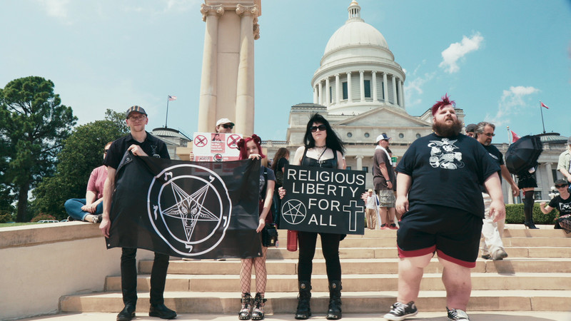 Members of the Satanic Temple at a protest in Hail Satan?