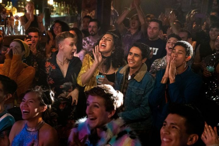 victor and his friends watch a concert in a new york city bar in love, victor