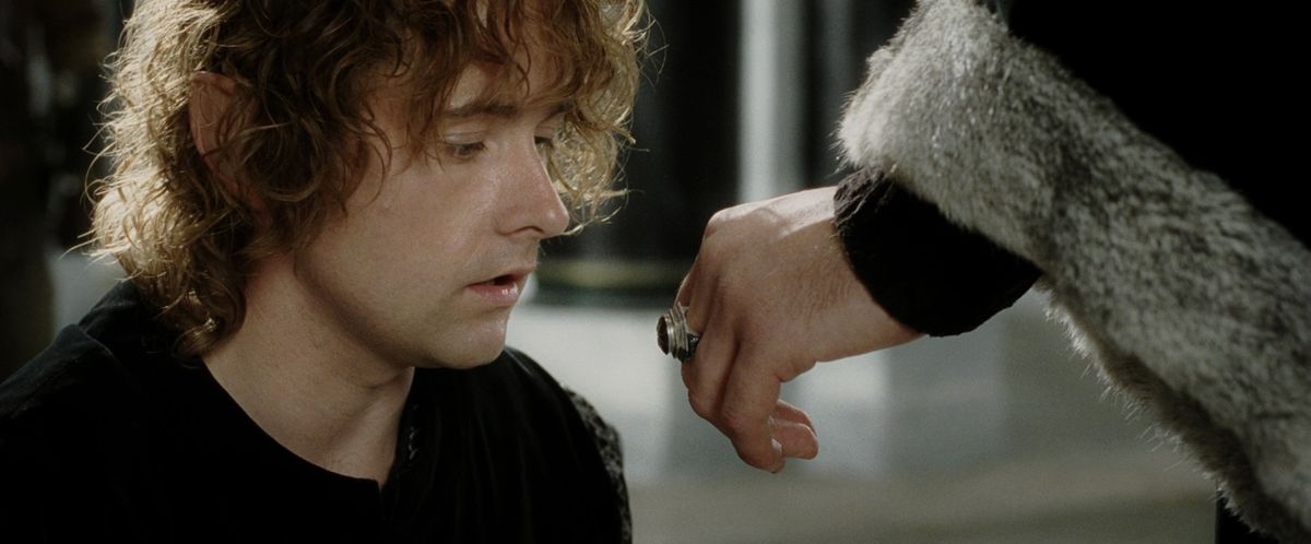 Denethor offers his ring to Pippin to kiss in The Return of the King.