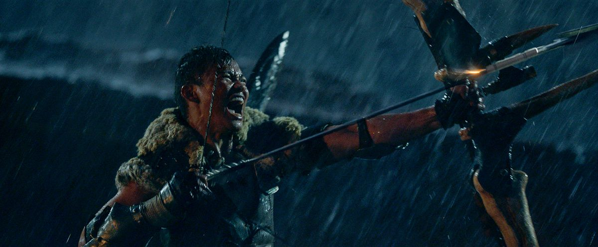 Tony Jaa, screaming in the rain and wielding his giant bow in Monster Hunter