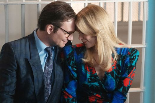 Christian Slater and Rachel Keller press their heads together and smile in jail in Dirty John