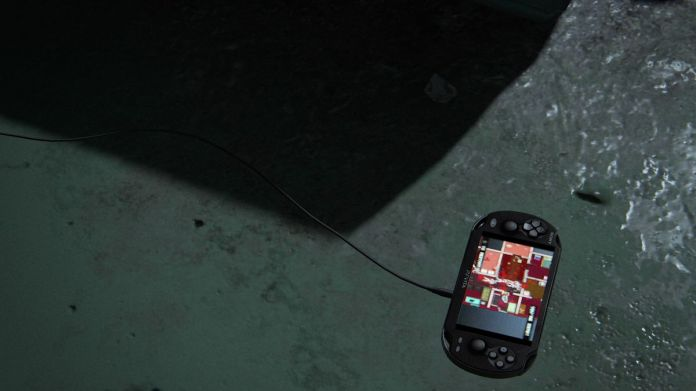 An abandoned PlayStation Vita sits on cement in The Last of Us Part 2