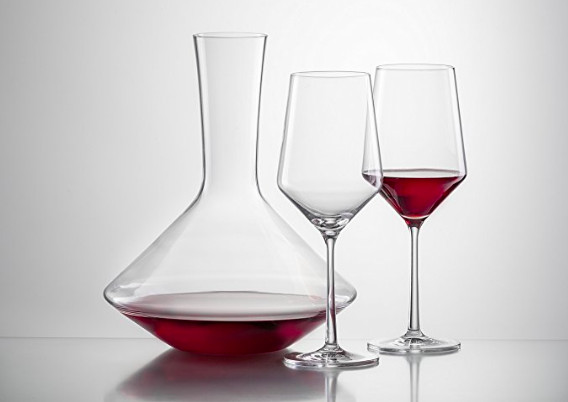 Schott wine glasses with decanter against plain gray background