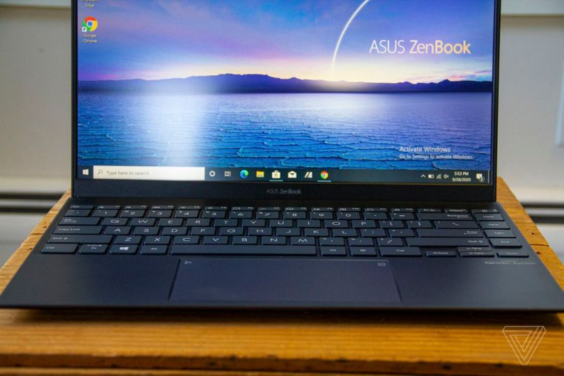 The Asus logo on the bottom bezel of the Asus Zenbook 14.