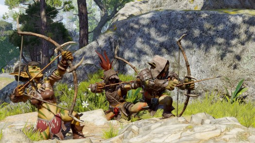 Three Goblin archers draw their bows