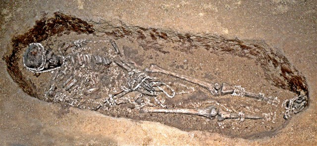 Upper paleolithic Sunghir burial decorated with ivory beads.