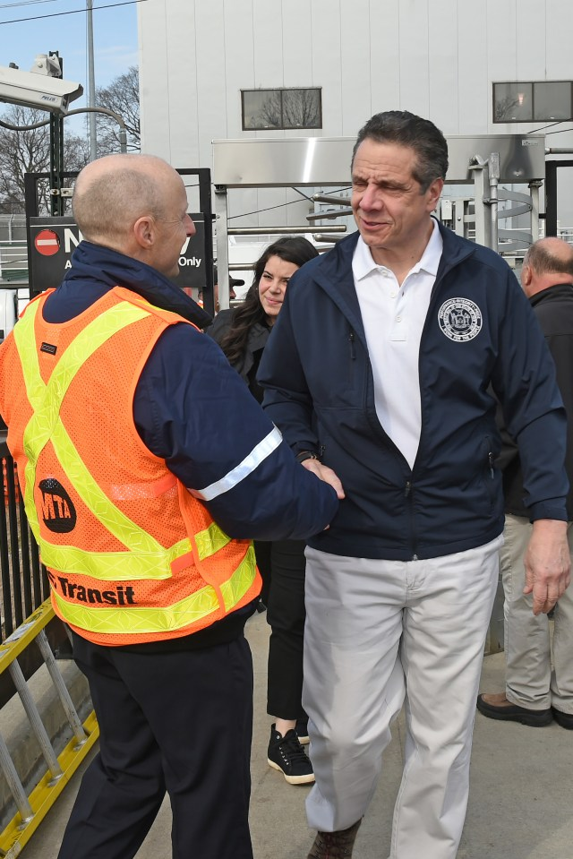 Governor Cuomo shakes hands with then-NYCTA President Andy Byford during a Brooklyn subway station opening, April 12, 2018.