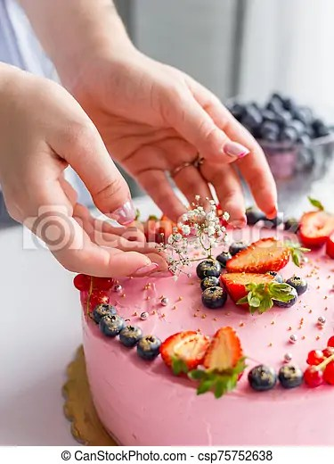 Woman Decorating Delicious Cake Homemade Pink Birthday Cake Decorated With Berries Strawberries Blueberries Red Currant Canstock