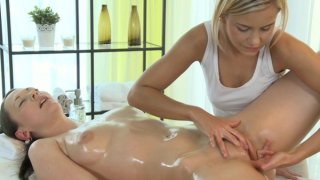 Oiled brunette babe massaged and fingered by cute blonde masseuse thumb