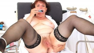 Eager head practical nurse playing with herself in her uniform thumb