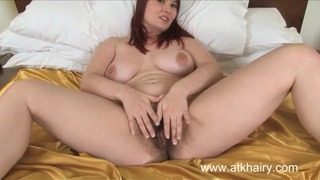 Busty Alabama is fucking her hairy pussy with a dildo thumb