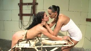 Bettina DiCapri and Mandy Bright tied hard with rope thumb