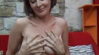 Busty czech MILF gives lapdance and handjob to kinky guy thumb
