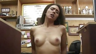 A sexy brunette fucked in the office thumb