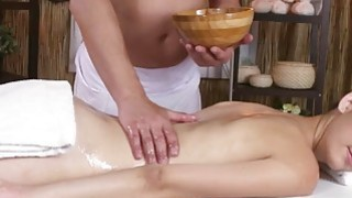 Sexy brunette enjoying a hard cock on the massage table thumb